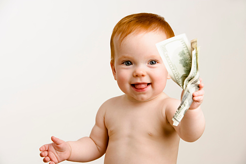 Baby holding wad of money