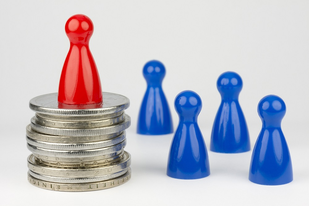 Conceptual financial position represented with colored play pieces and coins